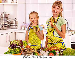 Children cooking at kitchen. - Children little girl cooking...