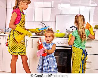 Children wash kitchen - Children little girl wash kitchen at...