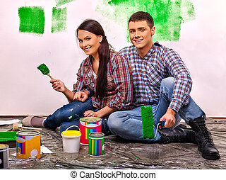 Family paint wall at home - Happy family paint wall at home...