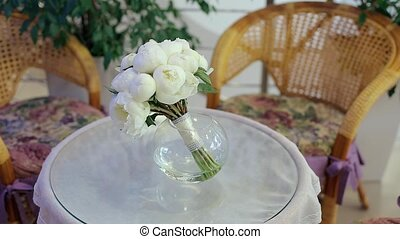 Bouquet of White Flowers Lying on the Table