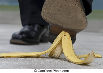 Businessman and banana skin - Businessman about to step on a...