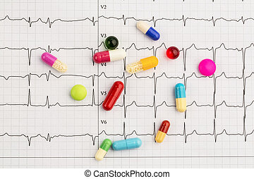 tablets on an ecg - several tablets lie on an ekg symbolic...
