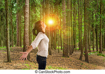 woman in forest - many trees in a forest with a woman who...