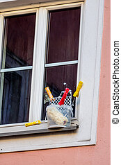 art supplies in front of a window, symbol of renovation,...