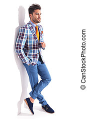 man standing with legs crossed and hand in pocket - smart...