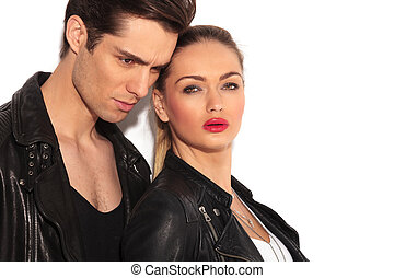 closeup of an embraced young couple in leather jackets,...