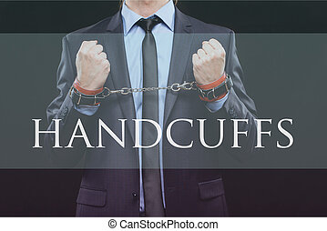 man in a business suit with chained hands. handcuffs for sex...