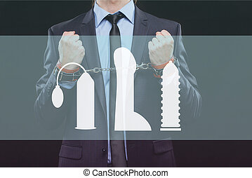man in a business suit with chained hands handcuffs for sex...