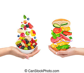 the choice of a healthy food or unhealthy food. Fruit salad...