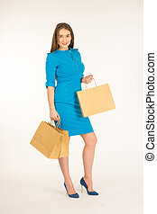Pretty woman in blue dress posing with bags - Pretty woman...
