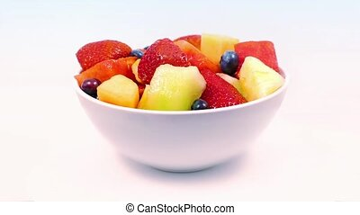 Bowl Of Delicious Fruit Rotating - Bowl of fruit salad with...