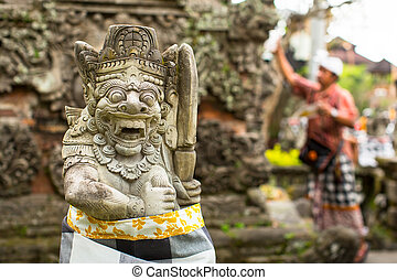 Traditional demon statue carved in stone on Bali, Indonesia.