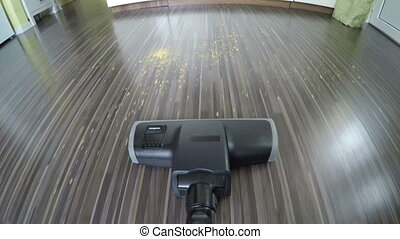 Vacuum cleaner point of view rolling back and forth on a...