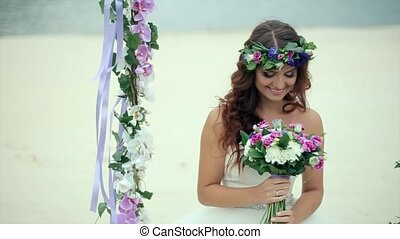 Happy Bride Considering the Bridal Bouquet - Happy Bride in...