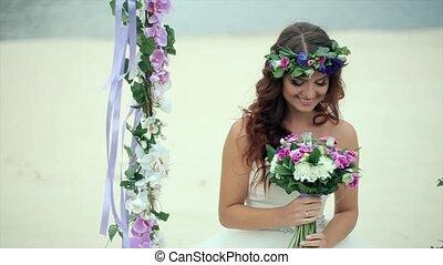 Happy Bride Considering the Bridal Bouquet - Happy Bride in...