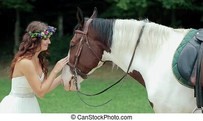 Pretty Girl  Lovingly Petting Her Beautiful Horse