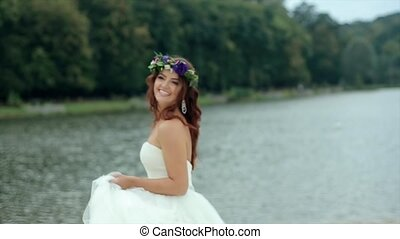 Happy Bride Turns Smiling to Camera - Happy bride in wedding...