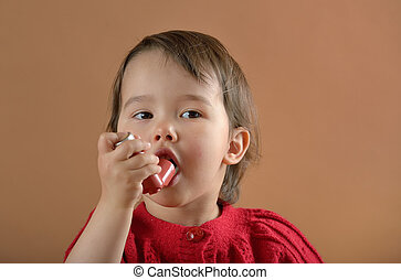 Little girl breathing asthmatic medicine inhaler - Little...