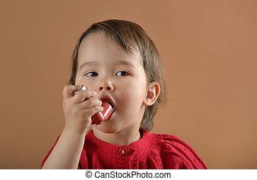 Little girl breathing asthmatic medicine inhaler - Little...