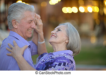 Senior couple dancing at evening - Happy senior couple...