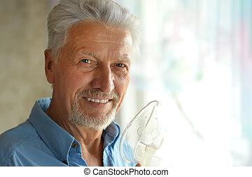 elderly man with flu inhalation - Portrait of elderly man...