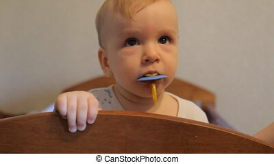 Baby chewing on the pacifier - Baby chewing on the headboard...
