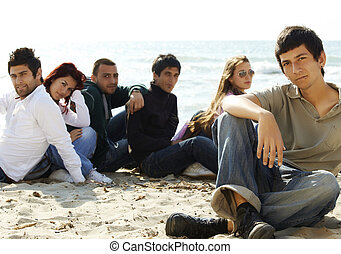 group of young friends on the beach