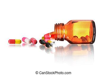 Pill bottle Pills spilling out of pill bottle