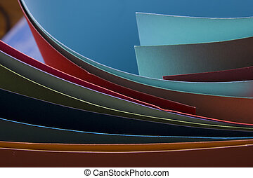 Abstract background.  Colorful curved sheets of paper.  Close-up shot