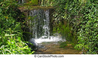 Beautiful Cascading Waterfall in the Park - Beautiful...