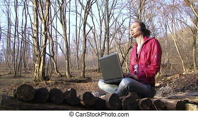 Woman finishes work with a laptop on the background of a...