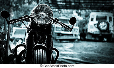 Vintage style Motor Bike in focus - a monochromatic image of...