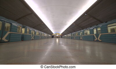 Underground station in Moscow with two passing trains - two...