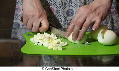 woman cuts eggs. cake cooking. homemade food