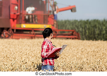 Woman agronomist in wheat field - Beautiful girl agronomist...