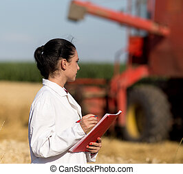 Woman agronomist in wheat field - Young woman agronomist in...