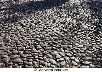 Abstract background of cobble stone road. Early morning...