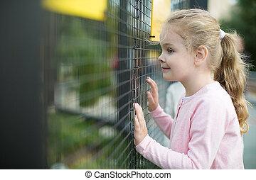 Spectator - Little smiling girl in zoo