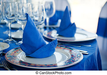 beautiful table with blue napkins