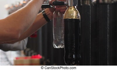 filling a bottle of brown ale - filling a plastic bottle of...