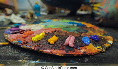 Artists oil paints multicolored closeup abstract. Workshop