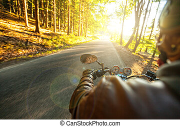 Motorcyclist riding motorbike in sunny morning -...