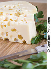 cheese - yellow cheese with large holes and parsley