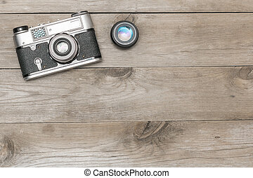 retro camera lying on the aged boards, flat lay