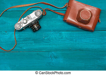 retro camera and cover lay on the aged boards, flat lay