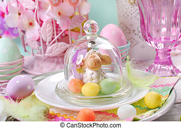 easter table decoration in pastel colors with lamb and candy...