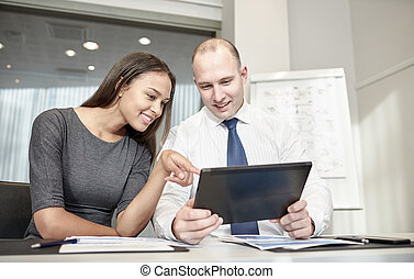 smiling businesspeople with tablet pc in office - business,...