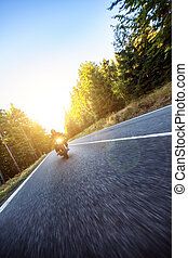 Motorcyclist riding chopper on a road - Motorcyclist riding...