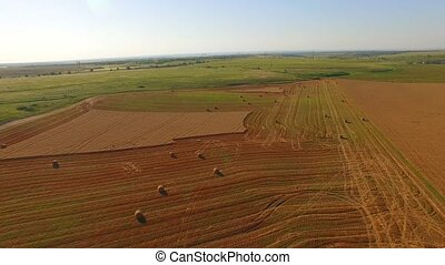 Rural Landscape With Bales On Harvested Field - PAN SHOT...