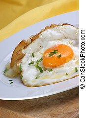 roasted potato with fried egg on a plate